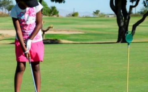 Young Girl Golfing