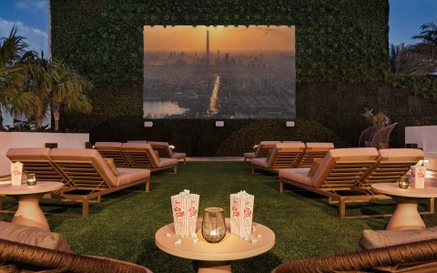 Loungers set up on hotel rooftop for movie