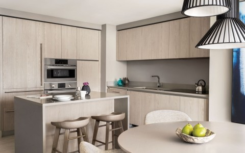 In room kitchenette with bar seating and dining table