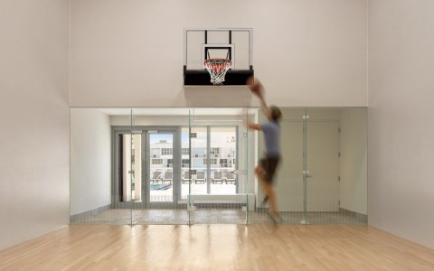 Man playing basketball indoors