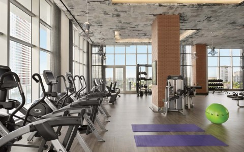 Gym with fitness machines and workout mats