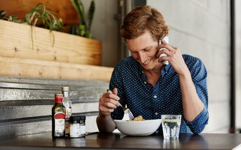 Man eating while on the phone