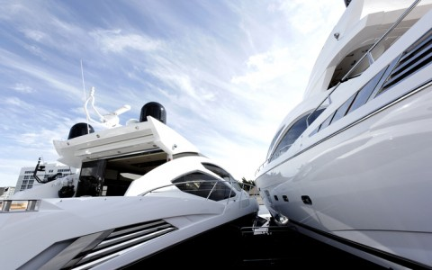 two white yachts docked side by side at a marina