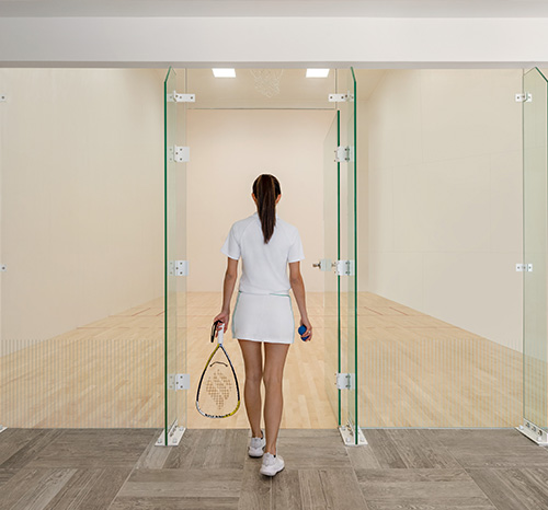 woman entering racquet ball room
