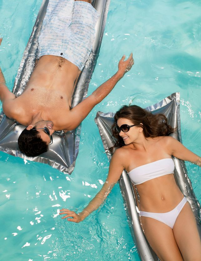 couple laying by the pool