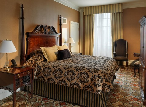 a guest room with a queen bed
