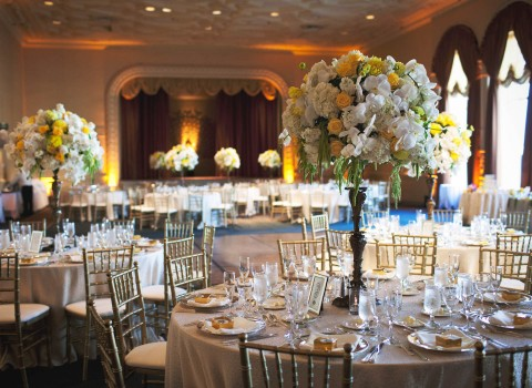 a banquet hall with table settings for a wedding
