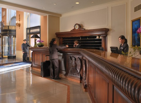 the lobby and front desk at the mark hopkins