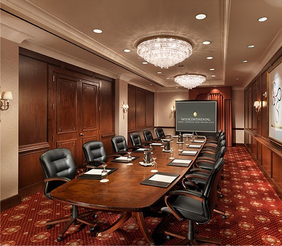 large meeting room with a big table and many chairs