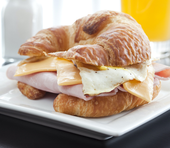 egg and cheese on a croissant