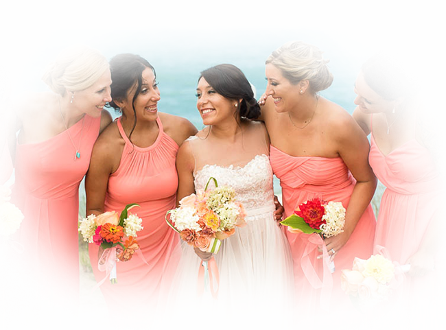 bridde and her bridesmaids in pink dresses
