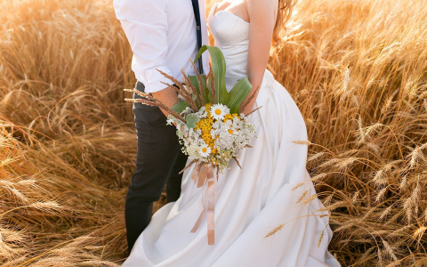 bride and groom in a beach field