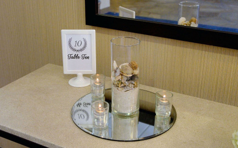 Illinois beach hotel table arrangement with placeholder and candles