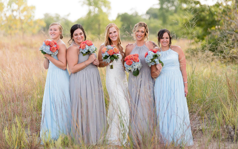 bridde and her bridesmaids in light blue dresses