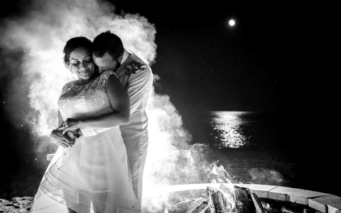 black and white image of bride and groom embracing