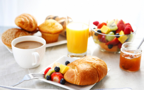 Breakfast with croissant, fresh fruit, juice & coffee