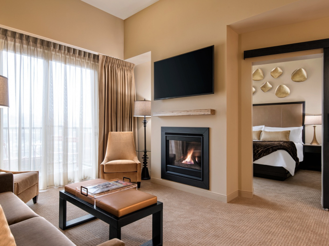 guest room with living area and fireplace