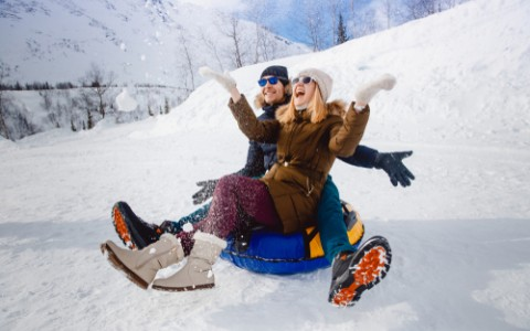 couple tubing in snow
