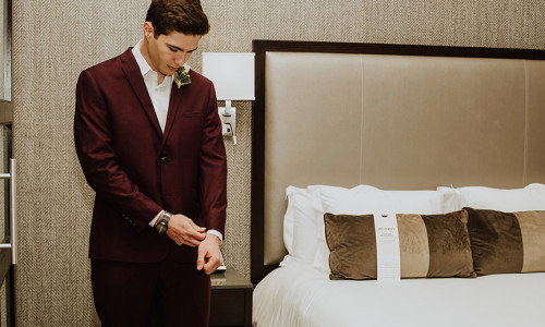 groom getting ready in hotel room