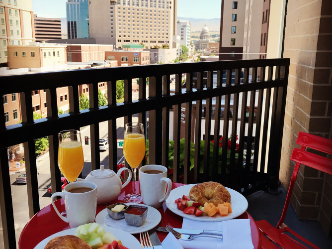 breakfast spread on a table on the balcony overlooking boise