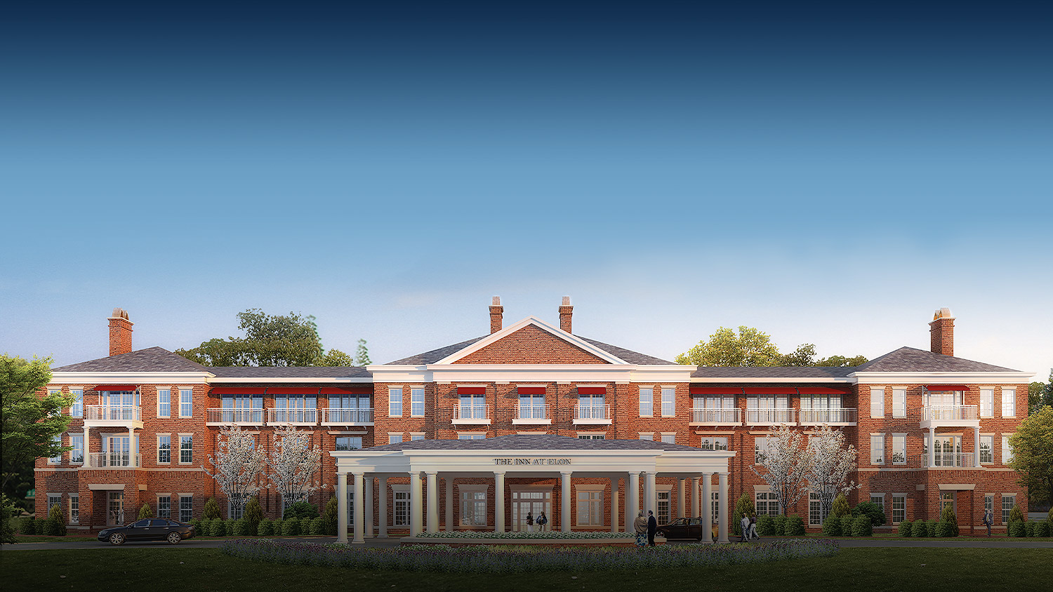 exterior of the inn at elon with red brick, symmetric design, and white columns