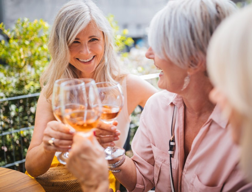 group of elderly women drinking wine