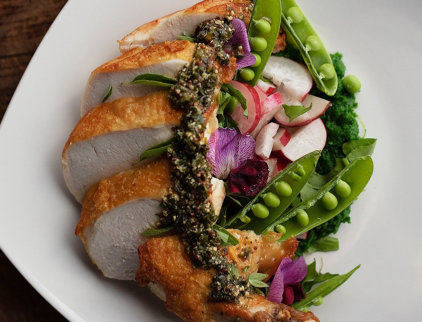 turkey sliced on plate with peas and veggies