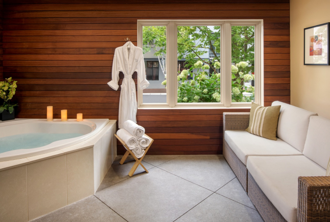 spa bathroom with siting area