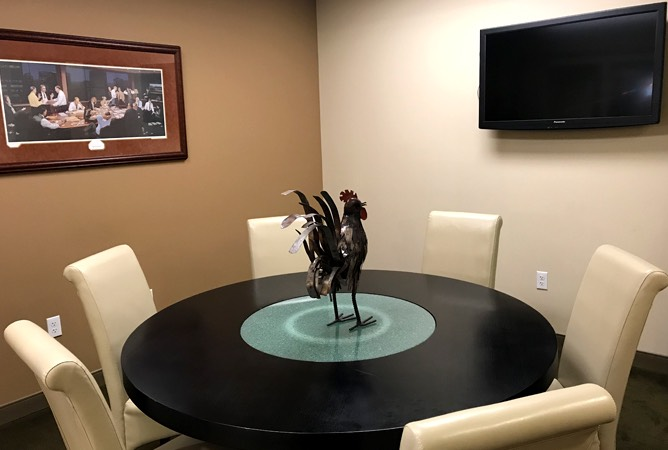 conference table with rooster centerpiece