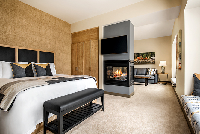 king bed in suite with fireplace