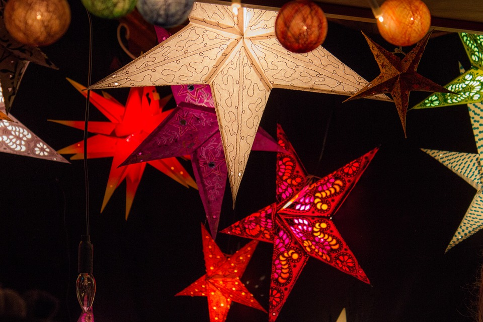 Star Shaped Lanterns Hang with Holiday Ornaments