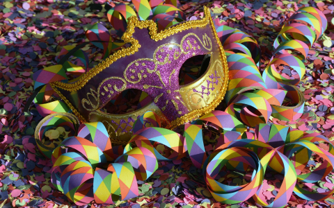 Colorful Mardi Gras Mask, Streamers, and Confetti