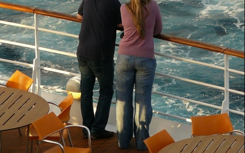 Couple Standing at Rail of Cruise Ship