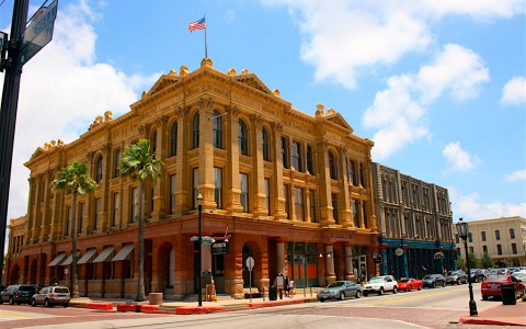 Historic Texas city building with palm trees