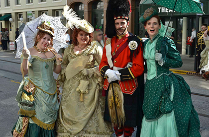 Group of four people dressed in Victorian-inspired outfits