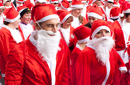 Large group of people dressed as Santa Claus