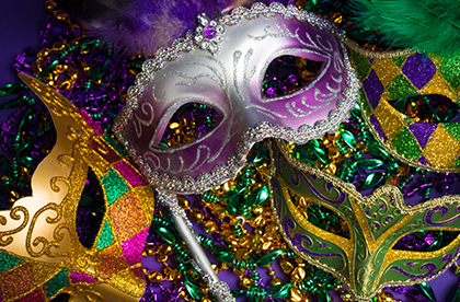 Close up of four festive Mardi Gras masks