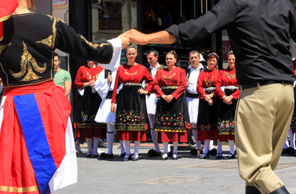 a group of dancers during a greek festival doing a traditional greek dance
