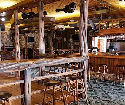 Bar stools and lounge area at the Inn Pub