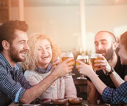 Group of friends clinking beer glasses