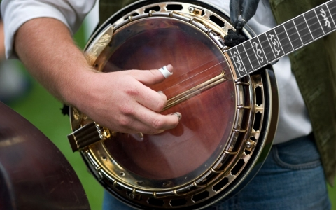 Close up of a man playing the banjo