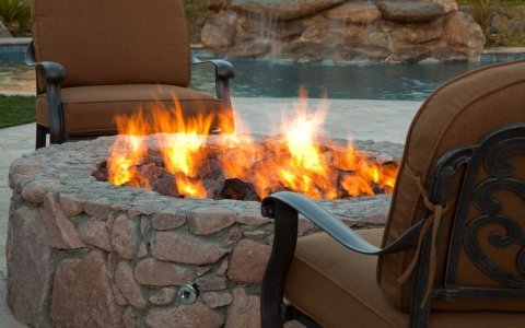 Two chairs at an outdoor fire pit