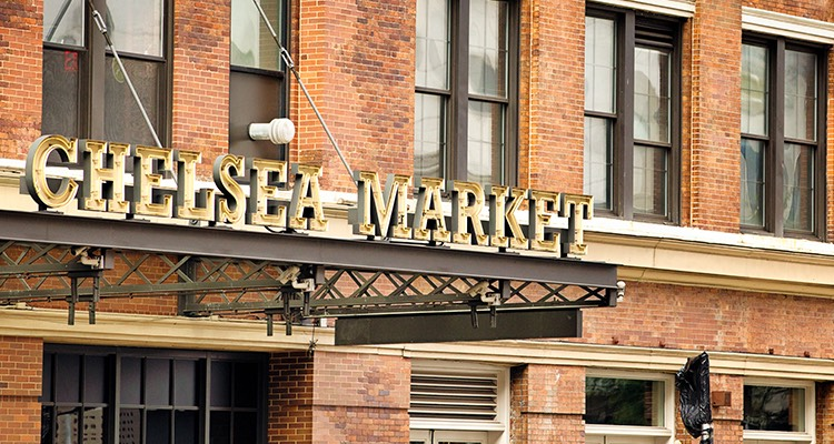 Chelsea market gold metal sign outside a red brick building