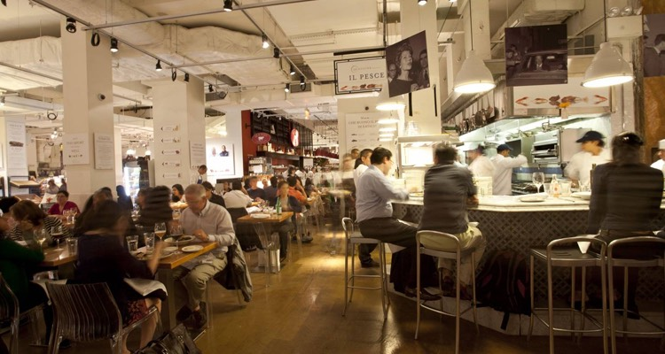 Restaurant with table and bar seating in Eataly