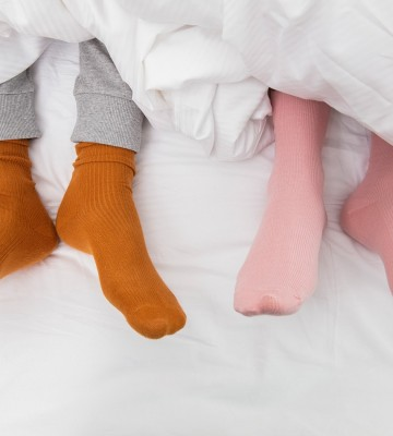 Man and woman wearing bright socks