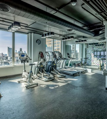 gym with equipment and window with skyline view