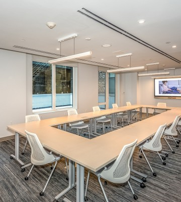 conference room with rectangular table and chairs