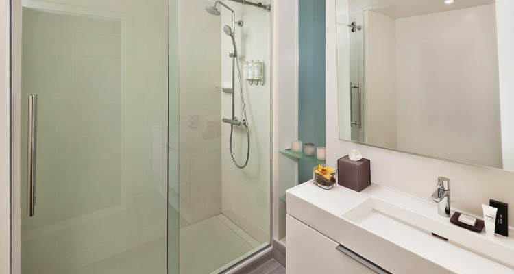 Full bathroom white sink and glass shower