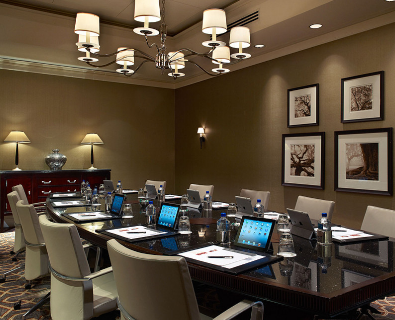 willard barclay boardroom meeting space with glass executive table and leather chairs