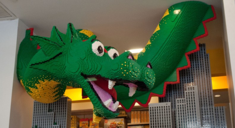 lego sculpture of a green dragon
